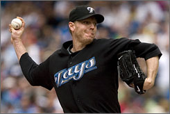 Blue Jays ace Roy Halladay pitches against the Red Sox on July 19. The trading deadline passed with Halladay staying put in Toronto.