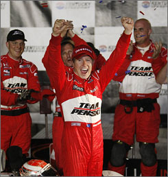Ryan Briscoe celebrates with his crew after edging Ed Carpenter in the final yards to win the Meijer Indy 300 at Kentucky Speedway.