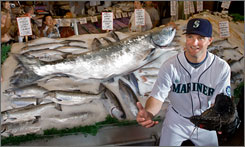 Mariners first baseman Russell Branyan, preparing to catch a salmon tossed his way at Pike Place Market in Seattle, has finally gotten a chance to be a regular player after years of bouncing from team to team and from the majors to the minors.