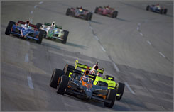 Danica Patrick holds a slight edge over eventual runner-up Ed Carpenter in a battle for position during Saturday night's 300-miler at Kentucky Speedway.