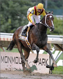 Rachel Alexandra, with jockey Calvin Borel aboard, overcame a sloppy track to win Sunday's Haskell Invitational by six lengths.