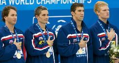 From left, Aaron Peirsol, Eric Shanteau, Michael Phelps and David Walters strike gold in the 4x100-meter medley relay.