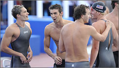 The American 400 relay team of (from left) Eric Shanteau, Michael Phelps, Aaron Peirsol and David Walters celebrates its victory in the finale of the world swim meet.