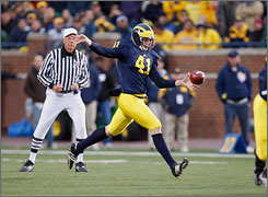 Michigan punter Zoltan Mesko, kicking the ball during an Oct. 25, 2008 game against Michigan State,  is a three-time  academic all-Big Ten  player and second in the Wolverines' record book for career punts and yardage.