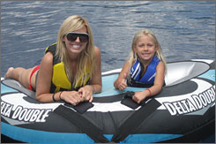 Courtney Force found a measure of relaxation, taking an inner-tube ride with niece Autumn at Lake Tahoe.