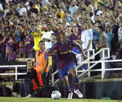Barcelona's Thierry Henry runs with the ball during a friendly against Los Angeles.