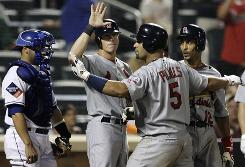 The Cardinals' Albert Pujols (5) celebrates with teammates after hitting a grand slam in the 10th inning Tuesday night.