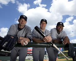 New Yankees A.J. Burnett, left, Mark Teixeira and CC Sabathia have flourished, unlike some past signees who struggled in the spotlight.
