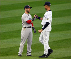 Derek Jeter's Yankees and Dustin Pedroia's Red Sox are first and second in the AL East standings, repectively.
