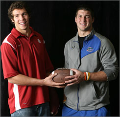 While Oklahoma's Sam Bradford, left, won the Heisman Trophy, Tim Tebow walked off with the national championship trophy last year.