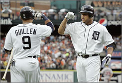 The Tigers' Miguel Cabrera, right, and Carlos Guillen celebrate after Cabrera blasted a three-run home run for half of Detroit's six runs in the first inning against the Twins.