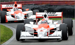 Ryan Briscoe shows the way ahead of teammate Helio Castroneves during qualifying at Mid-Ohio Sports Car Course.