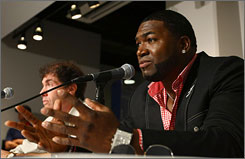 Boston's David Ortiz answers questions alongside Michael Weiner, the MLB players' association chief, during a news conference at Yankee Stadium.