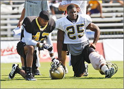 Saints running back Reggie Bush, right, has been limited to just 22 games in the past two seasons because of injuries.