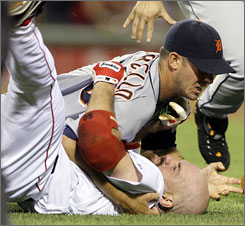 The Red Sox' Kevin Youkilis, below, wrestles with Tigers starter Rick Porcello after being hit by a pitch in the second inning. Both players were ejected.