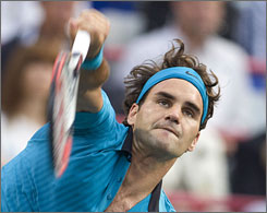 Roger Federer, serving to Canada's Frederic Niemeyer during their match at the Rodgers Cup, won his first match since capturing the Wimbledon crown.