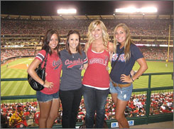 Courtney Force, second from right, and friends take in the sights during the Angels' game against the Rangers on Aug. 7.