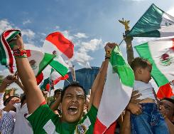 "Mexican fans celebrate in the ""Angel de la Independencia,"" one of Mexico City's major landmarks, on July 26, 2009, after their national team won the CONCACAF Gold Cup final against the United States."
