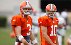 Derek Anderson, left, and Brady Quinn are competing for the starting quarterback job in Cleveland.