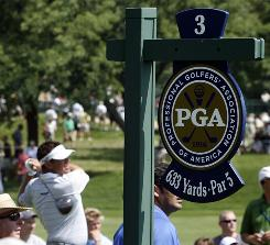 Lee Westwood of England tees off on the 633-yard par-five third hole during a practice round for the PGA Championship at Hazeltine National Golf Club in Chaska, Minn., on Aug. 11. Hazeltine National's 7,674 yard course is the longest ever for a major golf tournament.