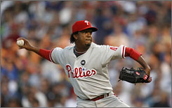 Pedro Martinez, making his 2009 debut with the Phillies, pitched five innings and struck out five to earn the victory over the Cubs.