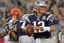 Quarterback Tom Brady threw two touchdown passes in his first game since tearing knee ligaments last September.