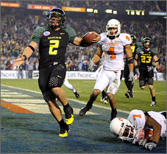 Oregon quarterback Jeremiah Masoli, scoring against Oklahoma State in December, will be wearing a helmet cam in practices.