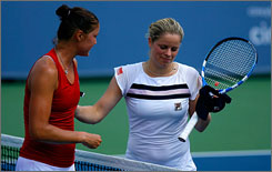 Kim Clijsters shakes hands with Dinara Safina after their quarterfinal match at the Cincinnati Open, which Safina won in straight sets.