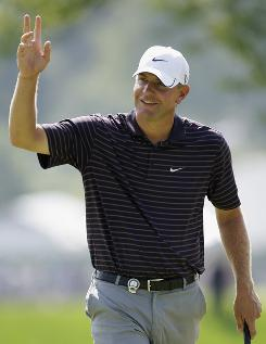 Lucas Glover waves to the gallery during the second round of the 91st PGA Championship at Hazeltine National Golf Club in Chaska, Minn.