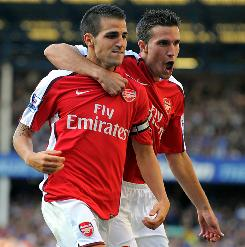 Arsenal's Spanish midfielder Cesc Fabregas, left, celebrates with Dutch striker Robin Van Persie after scoring the fourth goal in Arsenal's 6-1 English Premier League win over Everton on Saturday.