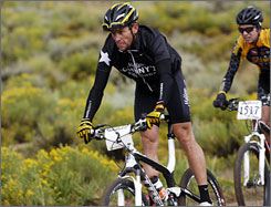 Lance Armstrong sets the pace on a dirt trail on the way to victory in the Leadville 100.