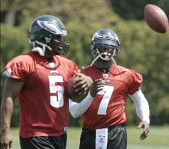 Philadelphia Eagles quarterbacks Donovan McNabb, left, and Michael Vick conduct drills during practice at the Eagles' practice facility on Sunday in Philadelphia.