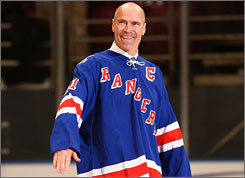 Rangers great Mark Messier takes part in the jersey retirement ceremonies for former teammate Adam Graves last February.
