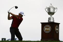 Defending champion Padraig Harrington started Sunday's final round solidly but finished even par and in a tie for 10th place.