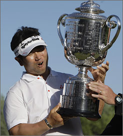 Y.E. Yang celebrates with the Wannamaker Trophy after beating Tiger Woods to win the PGA Championship.