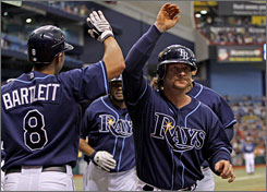 The Rays' Gregg Zaun hit his fifth career grand slam  the game winner in the eighth inning.