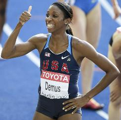 The USA's Lashinda Demus gives a thumb up after she finished first in her heat of the women's 400 hurdles on Monday.