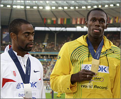 Tyson Gay and Usain Bolt receive their medals a day after Bolt won the world championship and broke his own world record in the 100 meters.