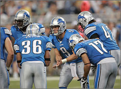 The Lions drafted QB Matthew Stafford (9) with the first overall pick after finishing 0-16 last season.