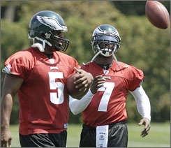 Donovan McNabb and Michael Vick participate in Eagles practice on Aug. 15. McNabb warned opponents that he and Vick could be on the field together this season, creating problems for opposing defenses.