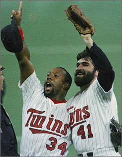 The Twins' Kirby Puckett, left, and Jeff Reardon celebrate after Minnesota won the 1987 World Series. Game 6 of that Fall Classic between the Twins and St. Louis Cardinals was the last time a World Series had a day game.