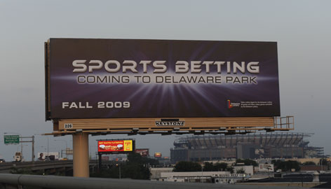 A billboard along Interstate 95 near Lincoln Financial Field in Philadelphia advertises that sports betting is coming to Delaware.