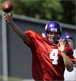Brett Favre throws a pass during Vikings practice after signing a contract with the team earlier in the day.