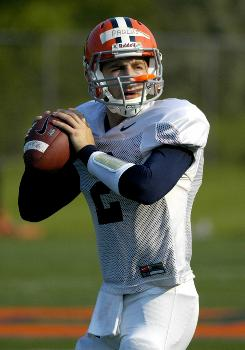 Greg Paulus practices with the Syracuse football team in Syracuse, N.Y., on Monday. After playing basketball for four years at Duke, he has been named the starter at quarterback for the Orange.