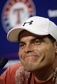 Ivan Rodriguez is all smiles after being acquired Tuesday in a trade with the Houston Astros.