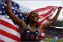 American Sanya Richards celebrates her first world title in the 400 meters.