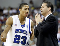Then Memphis coach John Calipari talks to his star player, Derrick Rose, during a timeout in 2008. The school's 38-2 record in 2007-08 and the NCAA tournament runnerup finish that season will be wiped out because of NCAA sanctions. 