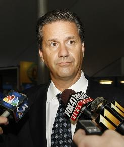 Kentucky coach John Calipari is questioned by reporters at the Kentucky State Fair in Louisville on Thursday. The NCAA will wipe out his 2007-08 Final Four season as Memphis coach, which makes him the only coach to have Final Four appearances vacated at two schools. His 1996 Final Four run as Massachusetts coach was also vacated.
