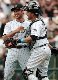 Rockies reliever Huston Street, left, celebrating with catcher Paul Phillips, knows this weekend's showdown with the Giants is meaningful.