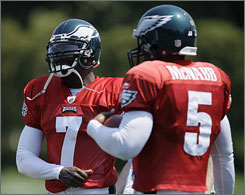 Donovan McNabb, right, recruited Michael Vick and helped lobby the Eagles to sign the disgraced quarterback.